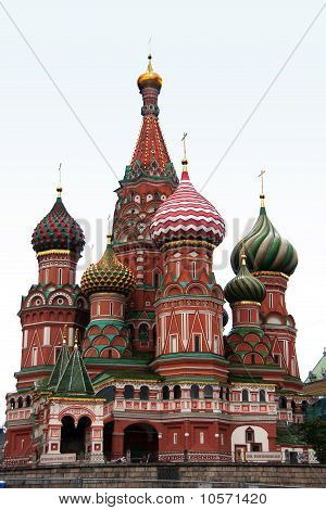 The towers of Saint Basil's Cathedral isolated against a light blue morning sky.