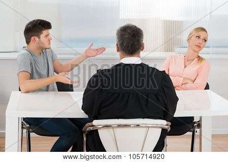 Judge In Front Of A Couple Having Conflict