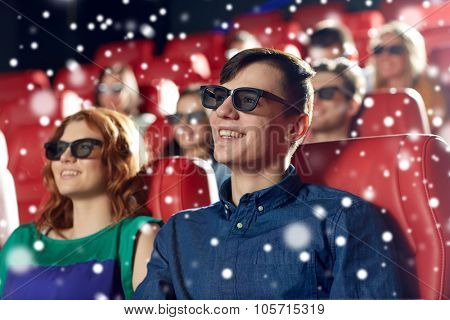 cinema, entertainment and people concept - happy friends or couple with 3d glasses watching movie in theater over snowflakes