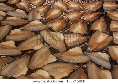 Dried Fish Slices On The Grid.