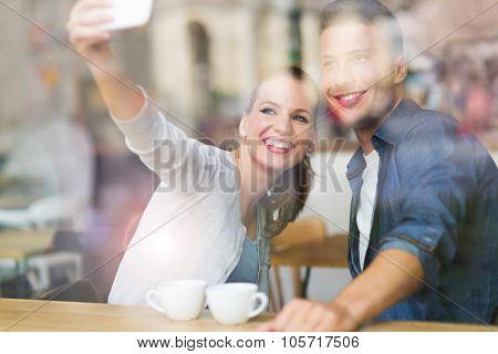Couple taking a selfie with smartphone