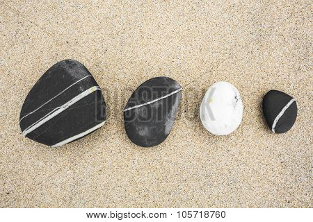 Top view of sea stones over the sand