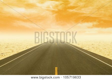 Asphalt Road Through The Desert At Sunset