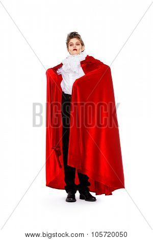 Full length portrait of a cool teen boy in a costume of vampire posing over white background.  Halloween. Isolated.