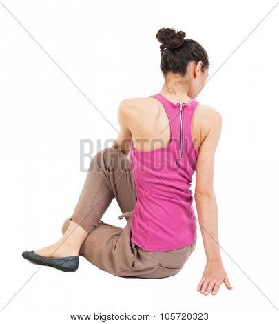Back view of the girl sitting in front of a warm up exercise.  Rear view people collection.  backside view of person.  Isolated over white background.