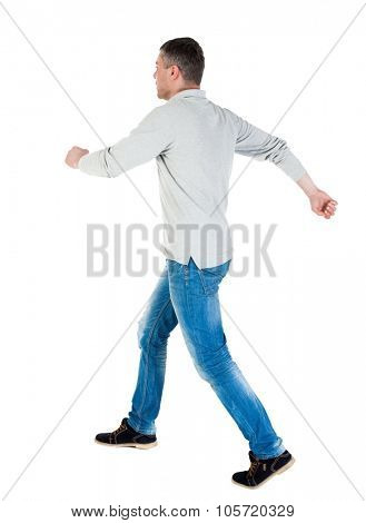 Back view of going  handsome man in jeans and a shirt.  walking young guy . Rear view people collection.  backside view of person.  Isolated over white background. A guy in a gray jacket is skipped