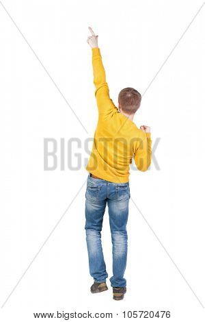 Back view of  man. Raised his fist up in victory sign.   Rear view people collection.  backside view of person.  Isolated over white background. A guy in a jacket dancing.