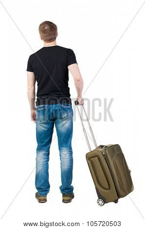 Back view of man with  green suitcase looking up. Rear view people collection.  backside view of person.  Isolated over white background. Tourist holding the handle of a suitcase on wheels.