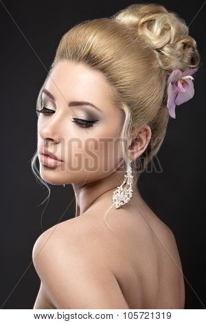Beautiful Blond Girl In Image Of The Bride With Purple Orchid In Her Hair