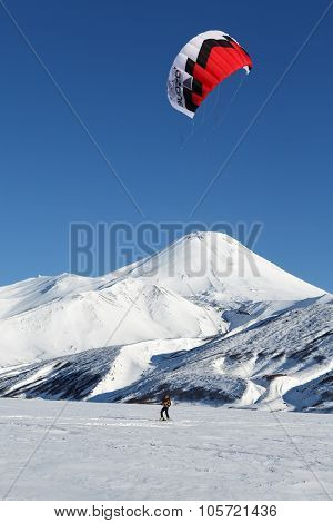 Snowkiting - Sportsman Glides On Skis On Background Volcano
