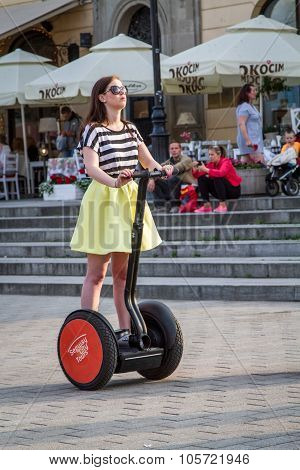 Girl stands on the Segway