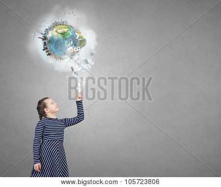 Adorable kid girl and Earth planet above her head. Elements of this image are furnished by NASA