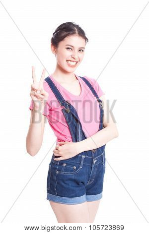 Young woman showing two fingers or victory gesture, isolated on white background