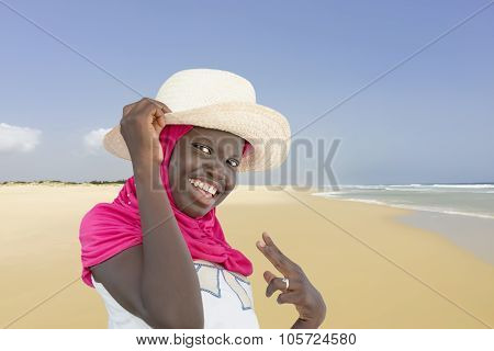 Young Muslim girl at the beach, ten years old
