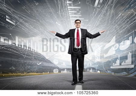 Confident businessman with hands spread apart on digital background