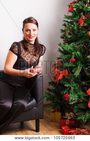 Lovely woman near by Christmas tree