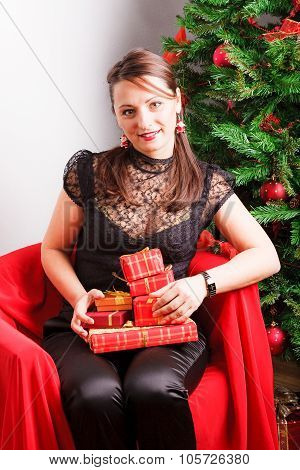Pretty woman holding pile of presents