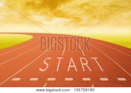 Outdoor Running Track With Sign Start At Sunset