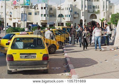 People walk by the street in Sfax, Tunisia.