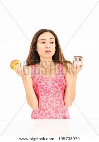 Woman Deciding Between Healthy Food And Junk Food