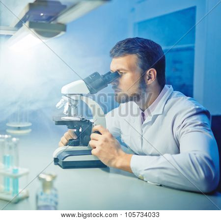 Young scientist studying new biotechnological substance