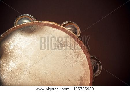 Wooden Tambourine On Brown Background