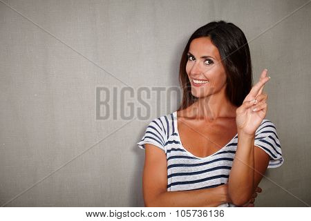Good-looking Woman Crossing Fingers While Standing