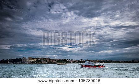 Barge Passengers And Cloudy Skies