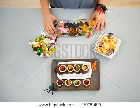 Woman Preparing Horribly Halloween Treats For Party. Closeup