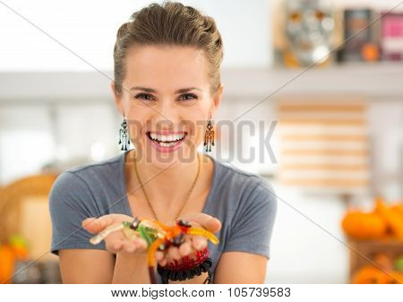 Woman Preparing Halloween Gummy Worm Candies For Kids Party