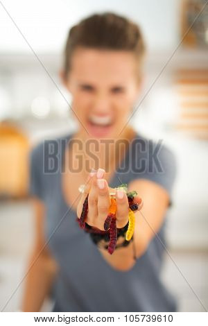 Closeup On Colorful Halloween Gummy Worm Candies In Woman Hands