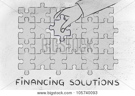 Hand Completing A Puzzle With The Missing Piece, Metaphor Of Financing Solutions
