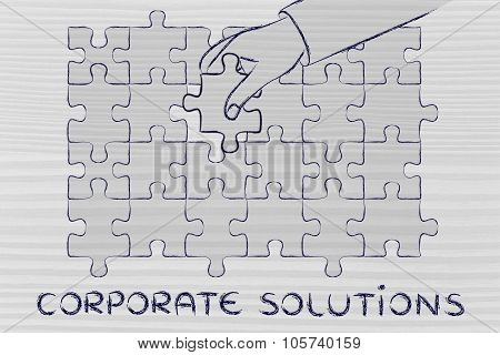 Hand Completing A Puzzle With The Missing Piece, Metaphor Of Corporate Solutions