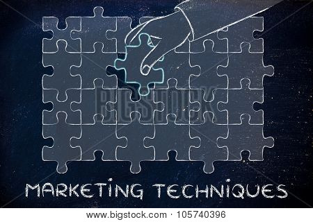 Hand Completing A Puzzle With The Missing Piece, Metaphor Of Marketing Techniques