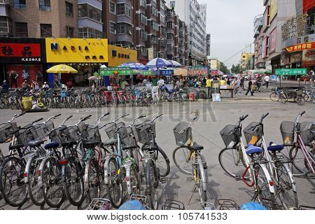 HOHOT, INNER MONGOLIA, CHINA - JULY 3, 2008: Dozens of bicycles - the most affordable transport for many residents - parked in the central business area