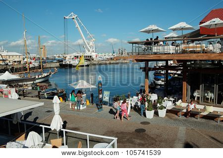 CAPE TOWN, SOUTH AFRICA - FEBRUARY 20, 2012: Victoria and Alfred Waterfront, harbor with shops, restaurants and boats popular with tourists.