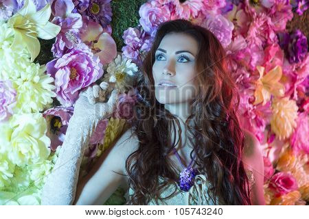 Beauty Fashion Women With Flowers Background. Summer And Spring Fashion Theme