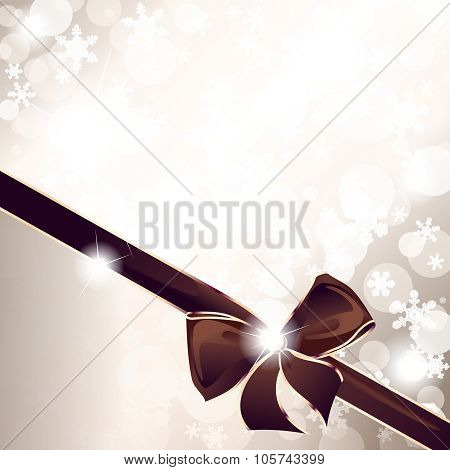 Golden sparkly holiday background with an elegant bow