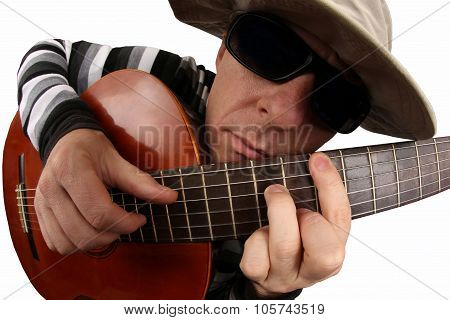 Man With Glasses And Hat Plays The Classical Guitar On White Background