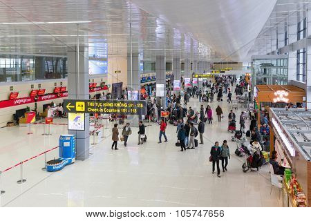 HANOI, VIETNAM, DECEMBER 21, 2014 : Large view on the NoiBai international Airport and the passengers queueing at the check-in counters of Vietjet airline in Hanoi, Vietnam