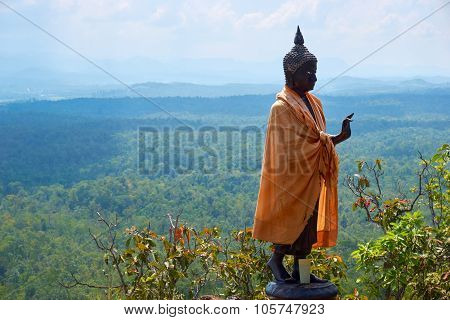 Buddha Statue Stand On Mountain Under Blue Sky