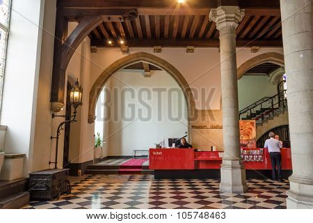 Bruges, Belgium - May 11, 2015: Tourists Visit Interior Of Museum Stadhuis On Burg Square In Bruges