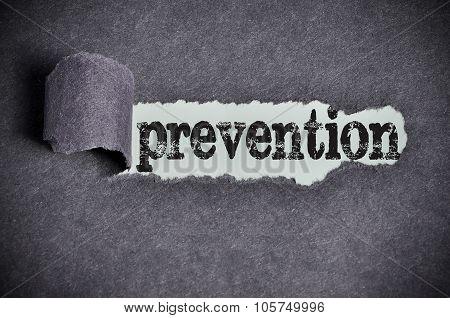 Prevention Word Under Torn Black Sugar Paper