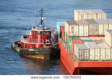 Tugboat Hauling Cargo Ship