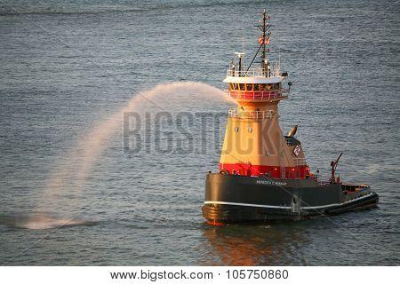Tugboat Spraying Water