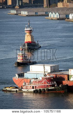 Tugboats And Cargo Ship In East River