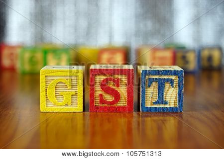 Word Of Gst Spelled With Colorful Wooden Alphabet Blocks.
