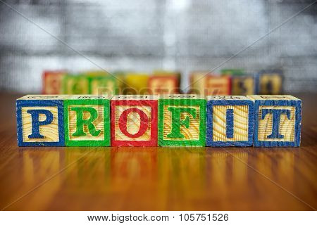 Word Of Profit Spelled With Colorful Wooden Alphabet Blocks.