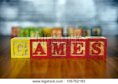 Word Of Games Spelled With Colorful Wooden Alphabet Blocks.