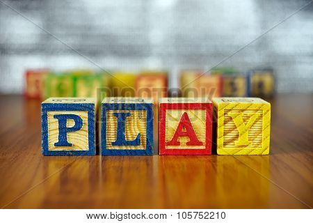 Word Of Play Spelled With Colorful Wooden Alphabet Blocks.